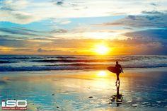 Surfing at Sunset. Desktop Background. Click to Download.