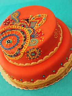 Indian Weddings Inspirations. Henna Wedding Cake. Repinned by #indianweddingsmag indianweddingsmag.com #weddingcake #orange