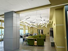 Pavo fixtures by SPI Lighting mounted on angles in a random configuration over a waiting area. Led Fixtures, Pendant Light Fixtures, Barbican, Waiting Area, Light Decorations, Spy, Decorative Lighting, Angles, Furniture