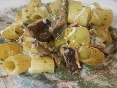 Pasta al forno con funghi, speck e mozzarella