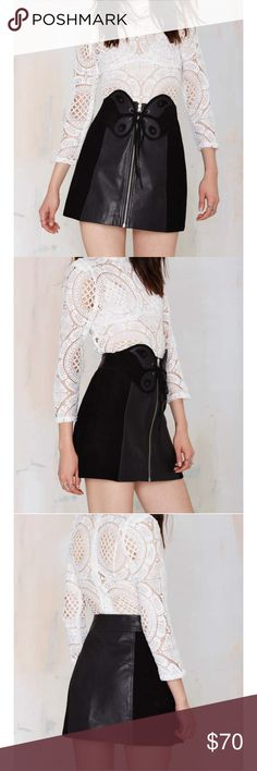 #215S so fly leather skirt 🐥💚 We're all about leather weather. This black suede skirt features leather panels at center, butterfly detailing at front with a lace-up closure, and an exposed silver zip closure. Fully lined. Pair it with a lace-up white blouse, moto boots, and an oversized clutch.  *Leather/Polyester  *Runs true to size  *Model is wearing size small  *Professional Leather Cleaner  *Imported Nasty Gal Skirts Mini