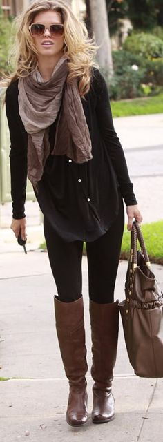 Black silky shirt, black leggings, brown boots, brown purse, brown scarf