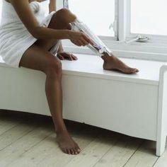 woman shaving legs - Stockbyte/Getty Images