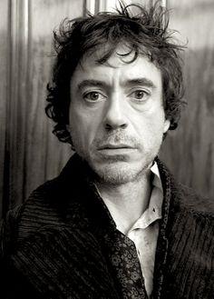 Robert Downey Jr. as Sherlock Holmes (2009).