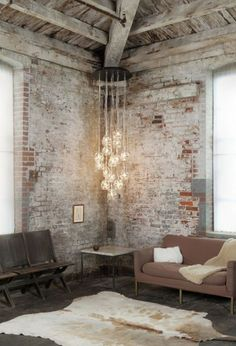 Industrial interior design. I love the worned brick wall...