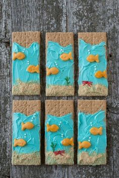 13 Healthy Kids Snacks - Healthy Snacks for Kids - Under the Sea Graham Crackers - Your kiddo will get a kick out of these fish-inspired treats. They're basically the perfect snack for the car ride over to soccer practice. Find more fun snack ideas for kids at redbookmag.com.