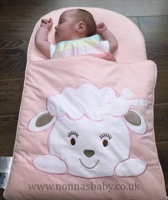 """Baby Lottie is so cute and comfy in her Cotton Candy Nap Mat. She looks so settled and content, and mummy Nadine told us that """"she absolutely loves it"""". That makes Nonna very happy! :-) • Find out more about Nap Mats: https://nonnasbaby.co.uk/baby-nap-mats/"""