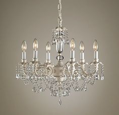 """brocade 6-arm chandelier $359 Faceted crystals and strands of glass beads drape from delicately detailed scrolling arms and petal-adorned ca...brocade 6-arm chandelier dimensions 22"""" diam., 20""""H"""