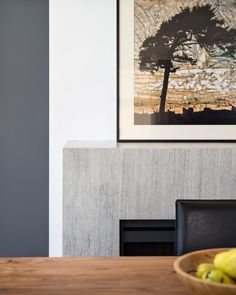 A White Wall Panel Provides Clean Separation Between The Charcoal Gray And Light Granite