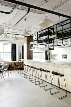 Gubi 3D barstools with a sled base steal the show in this minimalist space! Find them at urbanspaceinteriors.com