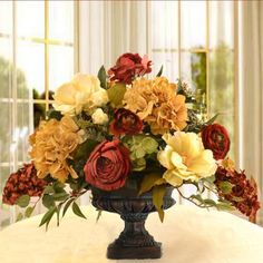 "Elegant Silk Flower Arrangement with Hydrangeas, Magnolias and Roses AR334-A - This silk flower arrangement will add elegance to any room. Created with high quality magnolias, hydrangeas, and roses. Accented with ivy in a lovely designer quality pedestal vase. The larger size is perfect for a dining or lager coffee table. Measures 22"" H x 28 "" W x 14""D #silkflowers"