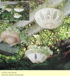 Rescue and reuse old light fixtures as planters.  Fabulous because they already have the drainage hole!  Create architectural interest in your garden with salvaged good.  Look for odd 'n ends pieces a - Click image to find more gardening Pinterest pins