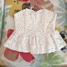 Urban Outfitters strapless top  - Size S Cream lace strapless top with peplum by label Pins and Needles. Zips up back. Perfect for a night out! 50% Nylon 50% cotton. Dry clean only. Urban Outfitters Tops Crop Tops