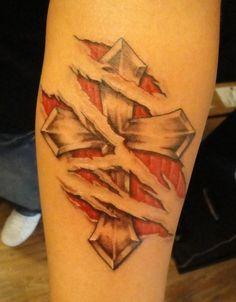 Ripped Skin Tattoos | Cross in Ripped Skin