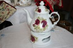 Teapot and tea light with dark red rose