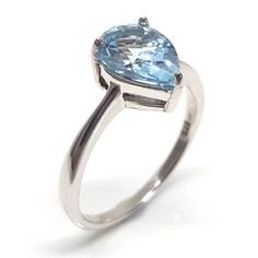 Capture the color of a blue sky summer with this pear shaped solitaire blue topaz gemstone ring. 925 silver and plated in rhodium for shine and durability 925 Silver, Silver Rings, Sterling Silver, Topaz Gemstone, Gemstone Rings, 4th Anniversary, Summer Sky, Prong Set, Solitaire Ring