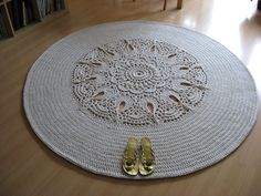 "I made this carpet to practice the ""Brenna"" pattern by Patricia Kristoffersen - I borrowed first 17 rounds, then made 13 more rounds of dc's. The whole work took me about 13 hours. I used up 1350 meters of cotton twine, 5 mm thick + a 9 mm crochet hook."