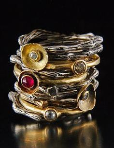 18kt gold and silver textured stacker rings with rubies, by Tai Vautier