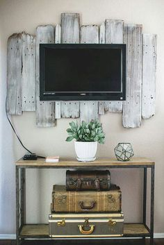Need to hang a tv up in your house? Make a reclaimed wood backdrop to secure your tv in place!