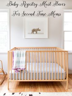 nursery design // baby rhino artwork by Sharon Montrose // ikea crib - Project Nursery - meadoria