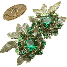 Vintage De Mario large floral earrings in shades of green rhinestones, layered with antiqued silver gilt filigree are in excellent vintage condition and could certainly rival anything created by Haskell check them out with the scan able photos at brendastreasures on rubylane.com!
