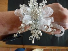 Snowflake wrist corsage winter wrist corsage by DuckBarnFlorals Wrist Corsage Wedding, Bridesmaid Corsage, Wedding Bouquets, Prom Corsage, Wedding Dresses, Brooch Corsage, Corsage And Boutonniere, Prom Flowers, Silver Flowers