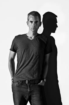 Head-on self portrait with profile shadow.