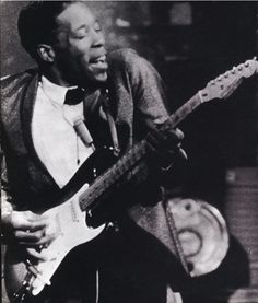 Buddy Guy, tearing up some South Chicago blues and lookin' fly.