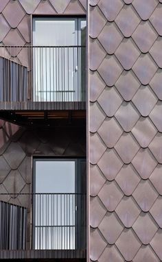 The external façade at Field Street/Leeke Street is clad in oxidised copper 'scales' that overlap and soften the dominant geometry of the building. Black Cladding, Zinc Cladding, Roof Cladding, Cladding Design, Interior Cladding, Exterior Wall Cladding, External Cladding, Aluminium Cladding, House Cladding