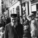 Year 1940.  Photo from the period of Nazi occupation in Warsaw.  The Jewish population of the Zamenhof Street at the height of the house No. 32  Shot in a northerly direction