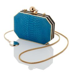 A modern combination of crisp blue and chic black textures you will love all year round. Limited Edition Blue Embossed Leather Shimmery black embossed leather #handbag #clutch #exotic #anniediamantidis