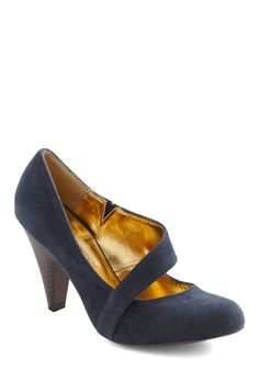 Looking for a cute navy blue shoe for Steph's wedding. Here's one option: Career Crossover Heel in Blue   Mod Retro Vintage Heels   ModCloth.com
