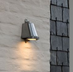 Wall-mounted outdoor fixtures are the chameleons of landscape lighting. You can install them on nearly any flat vertical surface.