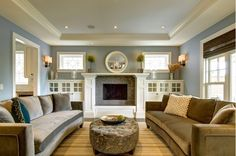 instead of fireplace, floor to ceiling built-ins are extended.  Living room by Rockwood Custom Homes, via Houzz
