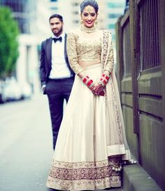 Lovely #IndianWedding #Lehenga in subdued shades, with red bangles  with <3 from JDzigner www.jdzigner.com