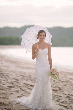 Stunning dress Read More: http://www.stylemepretty.com/destination-weddings/2014/05/14/romantic-costa-rica-wedding-at-reserva-conchal-beach-club/