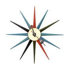 Lots of things are cooking in the desert heat, but nothing's hotter than this Sol Sunburst Wall Clock. Inspired by mid-century modern design, this decorative timepiece is unabashed in its display of technicolor beauty while sticking to the classic, timeless shape of a striking sculptural sunburst.
