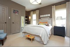 Wall color, trim and door all same paint color makes it a bit modern.