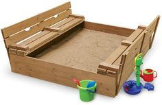 Wooden sandbox with bench seats