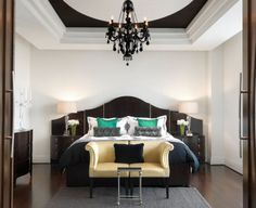 Dramatic painted recessed ceiling in an elegant bedroom