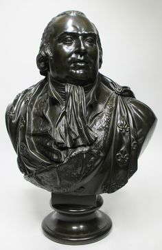 Attributed to Baron François-Joseph Bosio (Monaco, 1768-1845) A Very Fine French 19th Century Patinated Bronze Bust of Louis XVIII, the gazing slightly to sinister profile, wearing a coat, cravat and a cloak decorated with fleurs-de-lis and medals is one of several versions of Bosio's depiction of Louis XVIII, most of which are currently exhibited in several Museums around the world and in private collections. Circa: 1815-1820. By repute: A gift of Louis XVIII to Duke Decazes; The Heim G...