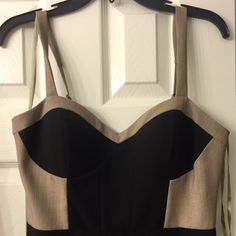 Arden B khaki and black color block cocktail dress Arden B khaki and black color block cocktail dress, bought but never worn! No tags. Just too small for me as you can see in the photo. But damn, it's a sexy classy dress!! Size Med but fits a 2- 4. Arden B Dresses