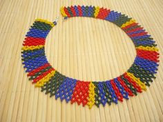 Scottish tartan inspired beadwork necklace. Used colors: dark green, dark blue, dark red, jellow. Made from czech seed beads. Its length 41 cm including clasp, width: 3,5 cm (1,38 in). If you have any request or question, please dont hesitate to contact me. I post the necklace in