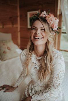 """""""I kept my hair loose and wavy with some braids worked in to hold a crown of fresh flowers. The makeup look was natural and dewy with a flush of peach to match the flowers""""- the bride 