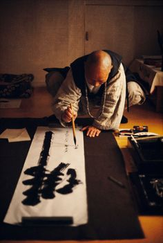 Master of the nine Mountains Calligraphingthe name of the Buddha. (South Korea),1973 © Roland  Sabrina Michaud