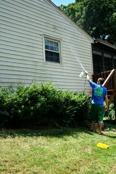 Spray dirty siding with a cleaner put into a sprayer that attaches to hose