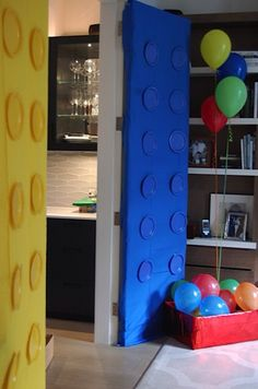 Turn your doors into giant LEGO bricks with disposable table cloths and matching paper plates.