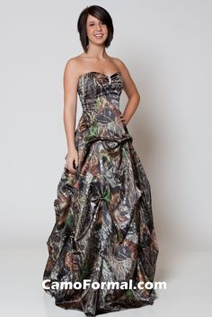 Sweetheart neck pickup dress with rhinestone pin at front bodice.  Pictured in Mossy Oak New Breakup. Available in many satin colors and all camo patterns in sizes 2-30. Made in the USA.