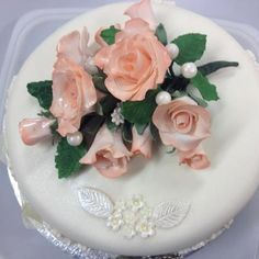 Lp  wedding cake with hand made rose spray