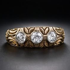 A trio of very bright-white and sparkling European-cut diamonds radiate from the top of this deeply carved 'Gypsy' style ring, crafted in 18 karat yellow gold with a graceful leaf and flower motif combined with abstract ornamentation. A marvelous three-st Three Diamond Ring, Unique Diamond Rings, Diamond Cuts, Art Nouveau Jewelry, Jewelry Art, Antique Jewelry, Vintage Jewelry, Vintage Rings, Gypsy Rings